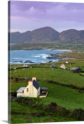 Ireland, Kerry, Sunset over the dramatic landscape of Ballydonegan Bay