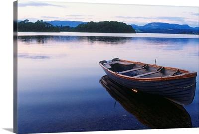 Ireland, Sligo, Lough Gill, boat at rest along the shore of the lake