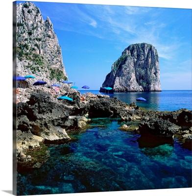Italy, Campania, Capri, Faraglioni and beach