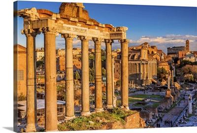 Italy, Rome, Roman Forum, Foro Romano Temple of Saturn, Coliseum in the background