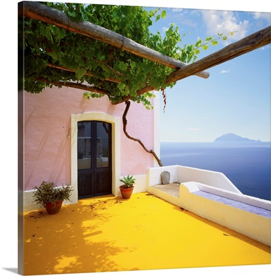 Italy, Sicily, Alicudi island, typical architecture and Filicudi island in background