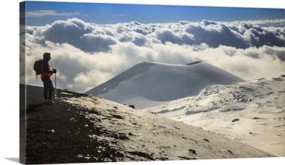 Italy, Sicily, Mount Etna, Hiker looking towards Escriva crater