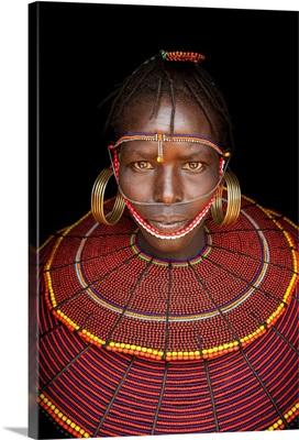 Kenya, Central, Pokot girl in traditional clothing