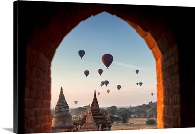 Myanmar, Dawn, Buddhist Temple, Stupas With Desert Land Sky Full Of Hot-Air Balloons