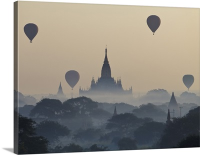 Myanmar, Hot air balloons flying over the Buddhist temples in the plain of Bagan