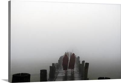 Myanmar, Mandalay, Amarapura, Monks walking across the U Bien bridge in the morning mist