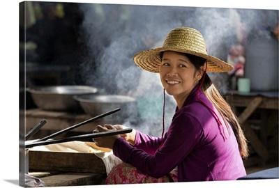 Myanmar, Mandalay, Bagan, Girl preparing food at a street market