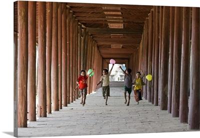 Myanmar, Mandalay, Bagan, Local children running along a corridor