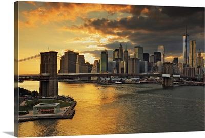 New York City, East River, Brooklyn Bridge, Downtown skyline at sunset