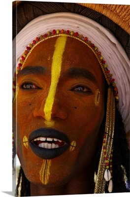 Niger, Wodaabe-Bororo men with face painted for the annual Gerewol male beauty contest