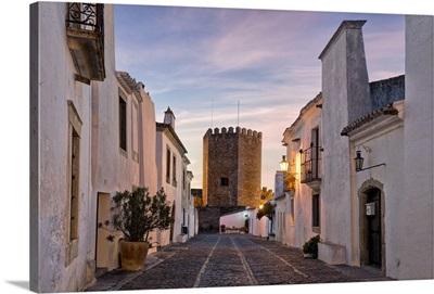 Portugal, Evora, Alentejo, Monsaraz, Cobbled village streets and castle at dusk