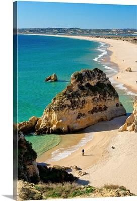 Portugal, Faro, Algarve, Alvor, Local man fishing at Praia de Alvor Beach in winter