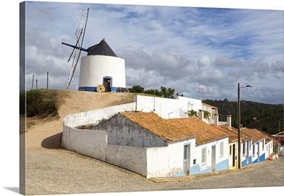 Portugal, Faro, Algarve, Parque Natural da Costa Vicentina, Windmill and colorful houses