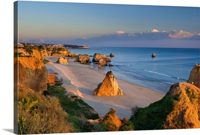 Portugal, Faro, Algarve, Portimao, Praia da Rocha beach in winter at dusk