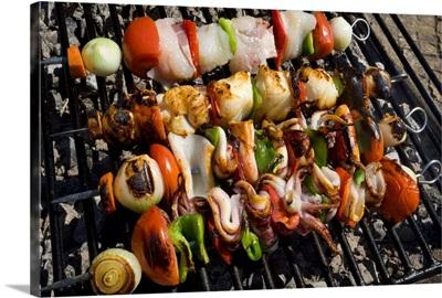 Portugal, Faro, Algarve, Portimao, squid kebabs on grill in street restaurant