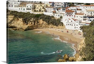 Portugal, Faro, Algarve, Praia do Carvoeiro, village and beach in winter