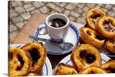 Portugal, Lisbon, Belem, Pasteis de Nata, custard tarts on a coffee table, bica coffee