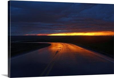 South Dakota, Badlands National Park, Sunset reflected on the road