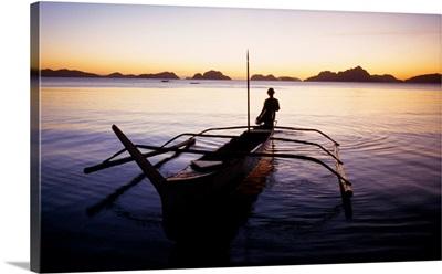 Southeast Asia, Philippines, Palawan, El Nido, outrigger boat (sampang) at sunset