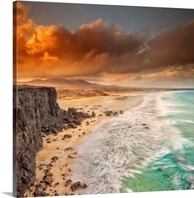 Spain, Canary Islands, Fuerteventura, El Cotillo, Beach and rugged coastline at dawn