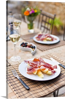 Spain, Mallorca, Pollenca, Spanish cured ham and local melon lunch