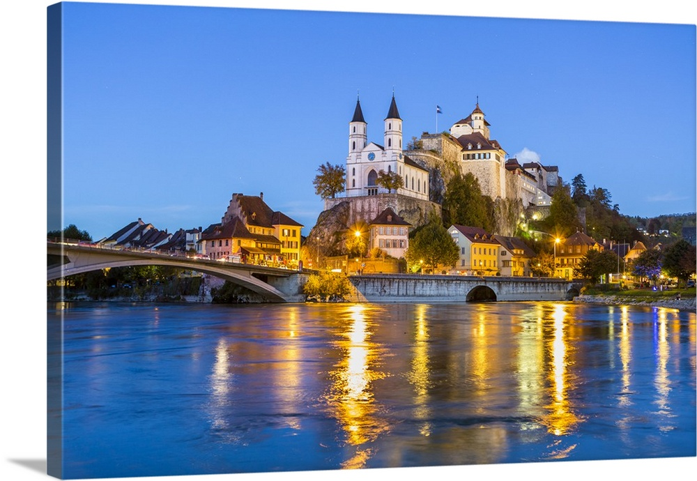 Switzerland Castle and church in Aarburg at night over river Aare