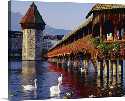 Switzerland, the covered wooden bridge and octagonal water tower