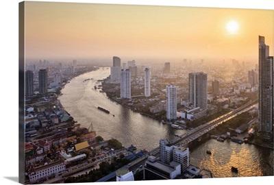 Thailand, Central Thailand, Bangkok, City skyline with Chao Phraya river at sunset