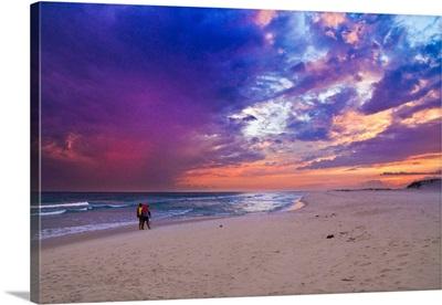 Pink Purple Clouds Sunset Walking Down Beach