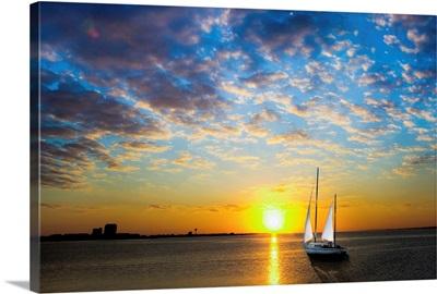 White Sail Sailboat-Sailing Into Sun-Sea Sunset