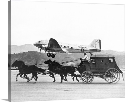 American Airlines DC-3 flying past horse drawn stagecoach
