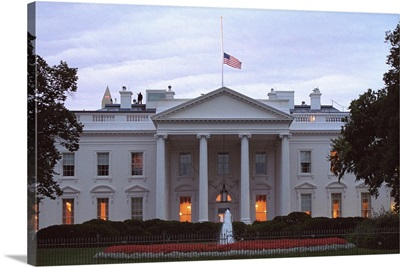 American flag flies at half-staff over the White House at sunrise Friday, Sept 14, 2001