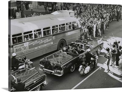 Dallas crowds waving as President Kennedy's limousine drives through downtown Dallas