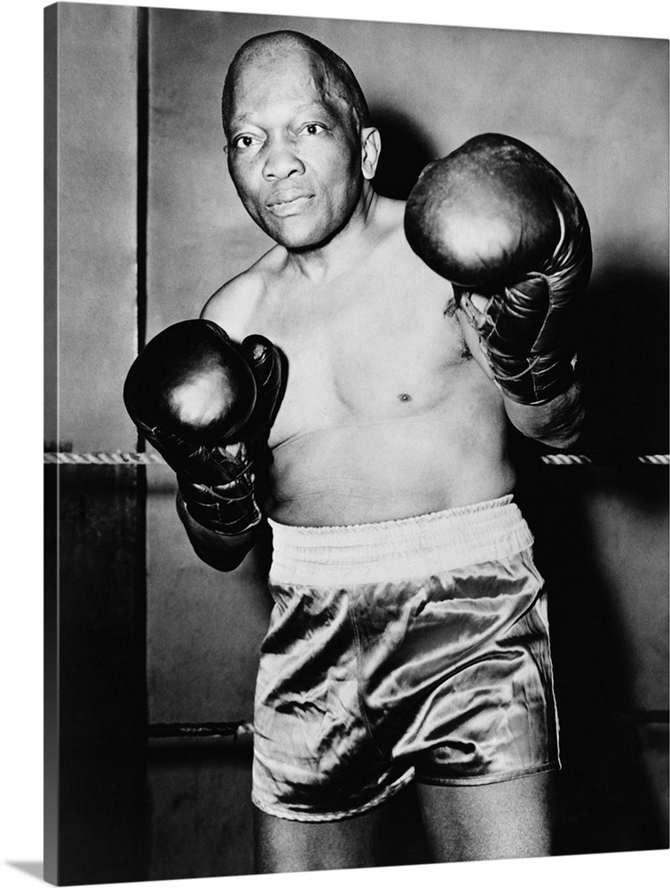 Former Heavyweight champion Jack Johnson in boxing pose, c  1930s