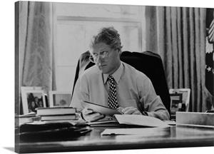 Informal Portrait Of President Bill Clinton At His Desk In