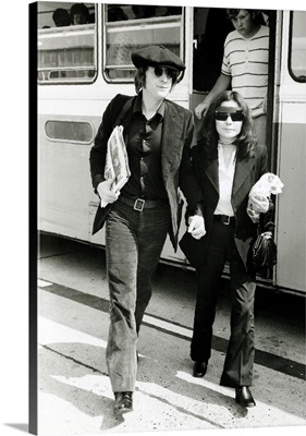 John Lennon And Wife Yoko Ono As They Arrive Back At Heathrow Airport, July 1971