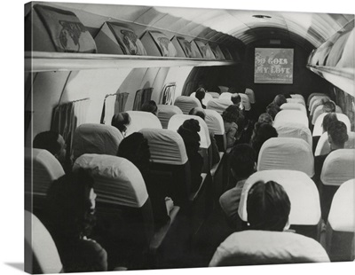 The film, 'So Goes my Love' is projected on a Pan American Clipper, August 6, 1946