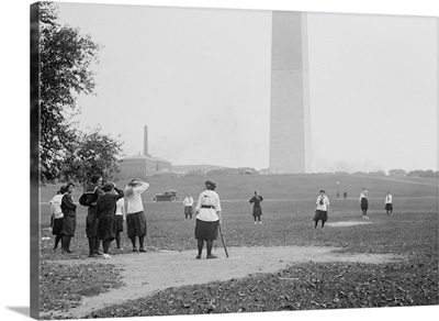 Young women in bloomers and middy shirts playing baseball