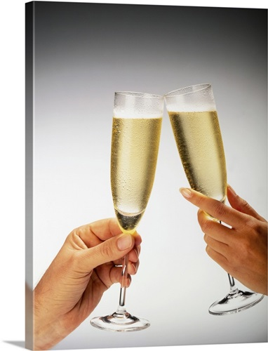 man and woman s hand holding glasses of champagne making a toast