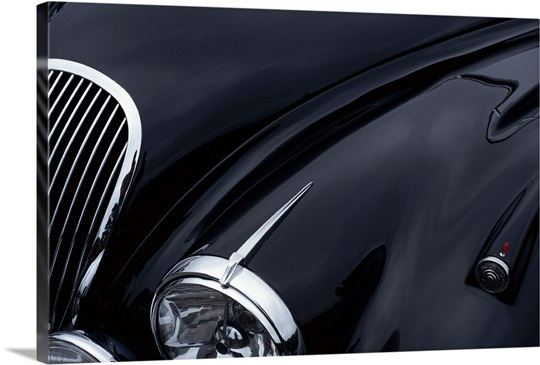 A Black Jaguar Sports Car Hood Showing A Grill And Headlight Wall