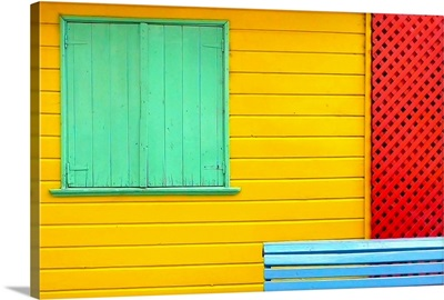 A colorful detail of Caminito in La Boca, Buenos Aires, showing green shutters