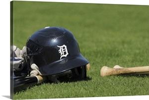 A Detroit Tigers Batting Helmet And Baseball Bat Sit On