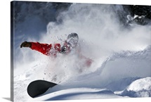 A snowboarder rips untracked powder turns in Colorado.