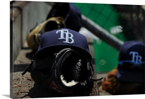 a-tampa-bay-rays-hat-and-glove-lying-on-