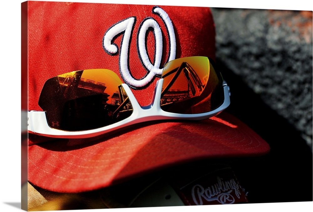 A Washington Nationals baseball hat sits with a glove and pair of  sunglasses Wall Art ab15768c0bd