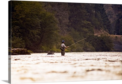 A young man fly fishing on the Klickitat River.