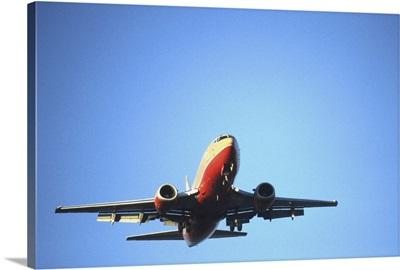 Aeroplane flying across blue sky