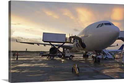 Airplane on tarmac at sunset