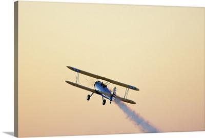 Airshow smoke trail at sunset.