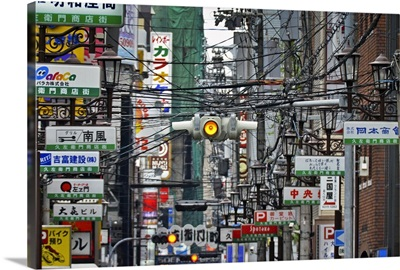 Amerikamura district, with chaos of street signs, lights, advertising and wires.